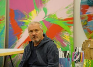 Images of Damien Hirst creating spin paintings in his studio in April 1995, both as below: