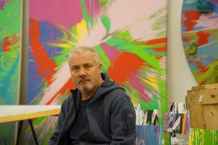 Images of Damien Hirst creating spin paintings in his studio in April 1995, both as below: